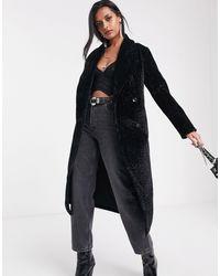 Religion Manteau long en fausse fourrure avec ceinture et imprimé jaguar - Noir