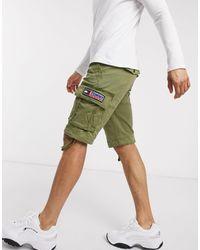 Tommy Hilfiger Pantalones cortos cargo lisos en verde oliva