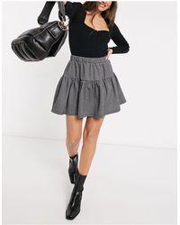 Y.A.S Mini-jupe d'ensemble à étages et mini motif pied-de-poule - Noir