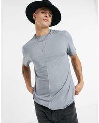 ASOS Camiseta con lavado desgastado - Gris