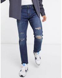 New Look Jeans slim con strappi blu medio