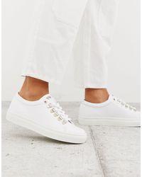 Swear – e Leder-Sneaker mit großen silbernen Ösen - Weiß