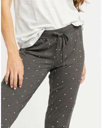 Lindex Joggers gris oscuro con diseño estampado