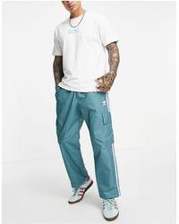 adidas Originals Брюки Карго Изумрудно-зеленого Цвета С Тремя Полосками Adicolor-зеленый Цвет