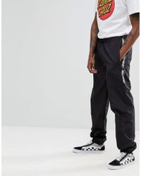 Santa Cruz - Gamma Track Joggers With Taping In Black - Lyst