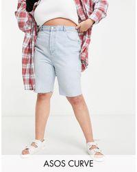 ASOS Shorts vaqueros largos estilo años 90 con lavado claro - Azul