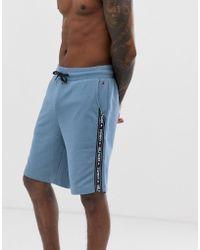 Tommy Hilfiger Short en molleton avec bande contrastante sur le côté - Bleu