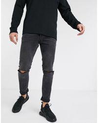 TOPMAN - Vaqueros ajustados con rodillas rasgadas en negro desgastado - Lyst