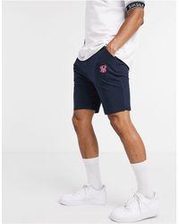 SIKSILK Pantalones cortos holgados en azul marino