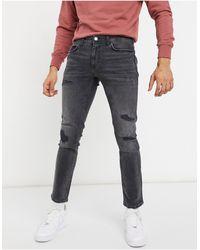 River Island Jeans skinny neri con strappi - Nero