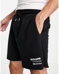 Sixth June Shorts s con bajos sin rematar y logo - Negro