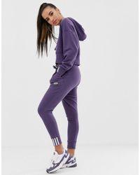adidas Originals Ryv Cuffed jogger In Purple