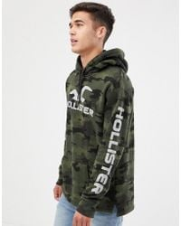 Hollister - Sports Back And Sleeve Print Logo Hoodie In Green Camo - Lyst