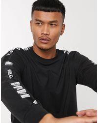 adidas Originals Adidas – Training – es, langärmliges Shirt mit Logo-Streifen - Schwarz