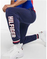 Tommy Hilfiger Joggers da casa con logo sulla gamba - Blu