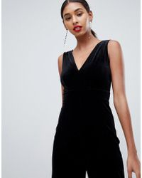 Lyst - TFNC London Halterneck Bodycon Catsuit With Mesh Sleeve in Black c521d404e