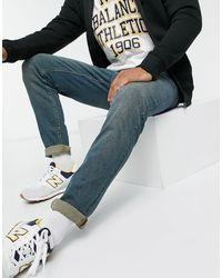 ASOS - Jeans skinny blu medio slavato vintage - Lyst