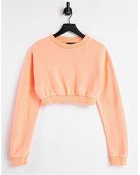 ASOS Sweat-shirt court à col montant - Corail fluo délavé - Rose