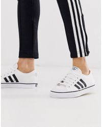 huge discount 35c9f bc882 White And Black Nizza Trainers