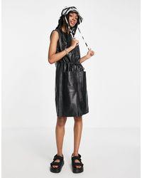 Muubaa Olivia - Robe en cuir sans manches style utilitaire - Noir