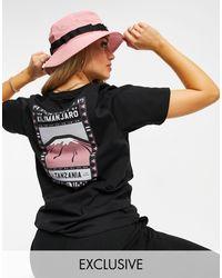 The North Face Camiseta en negro/rosa exclusiva en ASOS Faces de