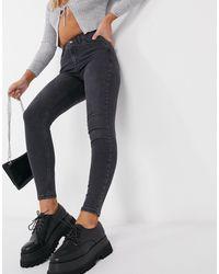 TOPSHOP – Jamie – Enge, beschichtete Jeans - Schwarz