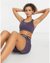 Nike - Фиолетовый Спортивный Бюстгальтер С Логотипом -фиолетовый Цвет - Lyst