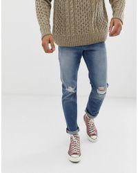 ASOS 12,5oz Smalle Jeans In Vintage Midwash Met Kniescheuren - Blauw