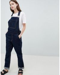WÅVEN Thea Rinse Indigo Denim Overall's With Wolf Embroidery - Blue