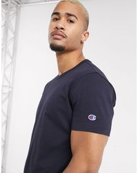 Champion T-shirt blu navy con logo sulla manica