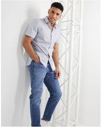 Lacoste – Gingham-Baumwollhemd mit regulärer Passform - Weiß