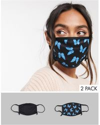 Skinnydip London Confezione da 2 mascherine con laccetti regolabili nero tinta unita con stampa di farfalle