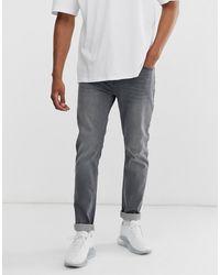 BOSS Taber - Jeans Met Smaltoelopende Pasvorm In Grijs