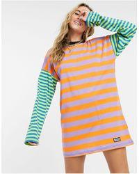 The Ragged Priest Vestido tipo camiseta extragrande con rayas en color block - Multicolor