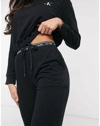 Calvin Klein Joggers confort con logo en negro CK One
