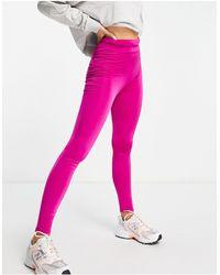 Flounce London Leggings deportivos fucsias con cordón ajustable y efecto moldeador en el trasero - Rosa