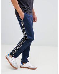 DC Shoes Joggers con cinta con logo en azul marino de