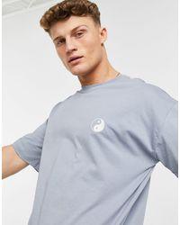 New Look T-shirt oversize avec broderie yin-yang - Bleu