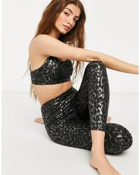 Onzie - – Yoga-7/8-Leggings mit hohem Bund - Lyst