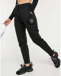 Criminal Damage Oversized joggers With Rhinestone Embellished Logo - Black