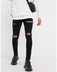 ASOS – Sprayon-Jeans mit Powerstretch und Abnutzungen, - Schwarz