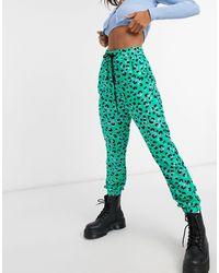 Love Moschino Jogger à imprimé léopard vif - Vert