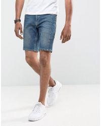 ASOS - Short skinny en jean style motard avec fermeture éclair - Bleu délavé foncé - Lyst