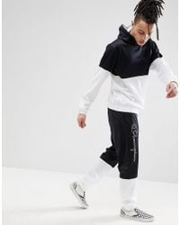 Champion Poly Tricot Tracksuit With Contrast Panels In Black