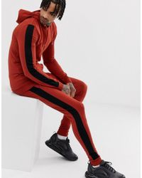 ASOS Tracksuit Muscle Hoodie/extreme Super Skinny jogger With Side Stripe In Rust - Orange