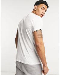 New Look T-shirt bianca con ricamo di rosa stilizzata - Bianco