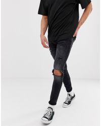 Jack & Jones Enge Spray-on-Jeans mit Zierrissdetail in verwaschenem Schwarz - Blau