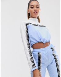 adidas Originals Ryv Taping Half Zip Sweat In Periwinkle Blue