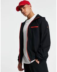 Ellesse Giacca nera con cappuccio zip e logo sul braccio - Nero