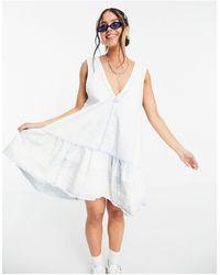 Free People – Sunspray – Mini-Hängerkleid aus verblichenem Jeansstoff - Blau
